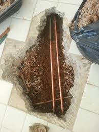 rerouting plumbing pipes versus digging slab