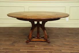 solid walnut round arts and crafts expandable dining room table solid walnut arts and craft expandable round table with white oak veneer