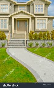 nicely paved curved doorway house entrance stock photo 113843764