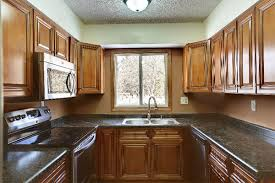 a cherry wood kitchen cabinet want to complement your cherry wood kitchen décor here s how