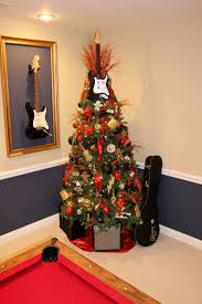 rock n roll christmas tree tatted gingerbread man fender guitar