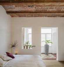 newly renovated minimalist apartment with stone wall and wooden