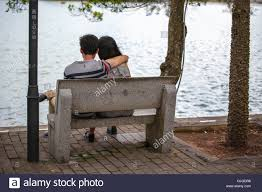 couple siting on the stone chair in huizhou west lake recreation
