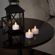 led pumpkin tea lights lavish home 1 5 in h led tea light candle set 24 piece 72 0240