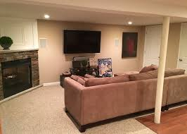 traditional basement with carpet u0026 exposed beam in hasbrouck