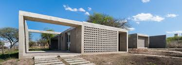 lozada blends concrete and glass for pair of low cost housing