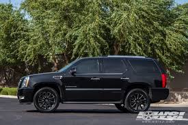 cadillac escalade with black rims 2015 cadillac escalade with 22 heavy hitters hh10 in black wheels
