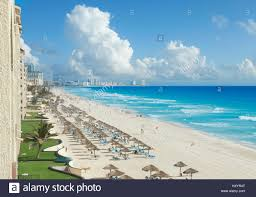 a view along the beach of the caribbean sea and hotels in cancun