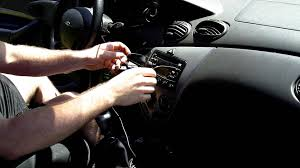 tutorial how to remove a car stereo with a coat hanger ford
