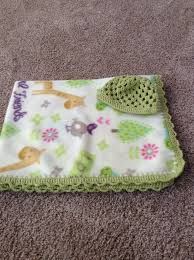 matching patterns fleece baby blanket with crocheted edge and matching hat