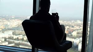 wine silhouette silhouette of young pensive man drinking wine on chair by window