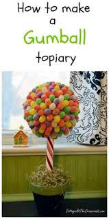 How To Make Ribbon Topiary Centerpieces by How To Make A Lollipop Topiary Centerpiece Topiary Centerpieces