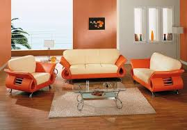 living room with colorful furniture and black walls burnt orange