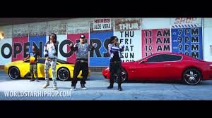 yellow lamborghini front migos and french montana standing in front of yellow lamborghini