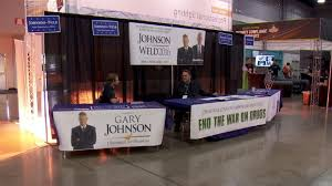 libertarian presidential candidate s staffers set up booth at