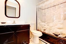 See Through Bathroom Dark Brown Bathroom With Wihite Wall And Beige Tile Floor Dark