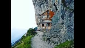 swiss hotel built on the mountain cliffs of swiss alps youtube