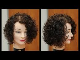 www step cut hairstyle that looks curly hair women s medium length haircut for curly hair thesalonguy