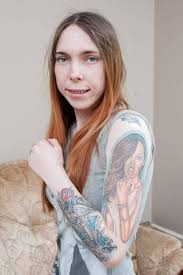 this spent thousands of pounds covering her body in tattoos
