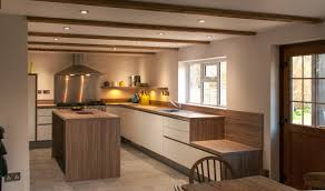 kitchen design brighton handleless white satin lacquer with stone oak worktops near brighton