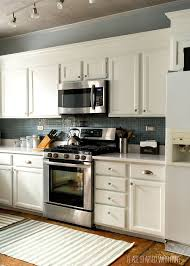 white kitchen cabinets counter tops blue gray backsplash of