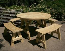 small round folding picnic table with detached benches in the