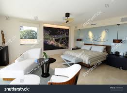 upscale uncluttered master bedroom suite luxury stock photo
