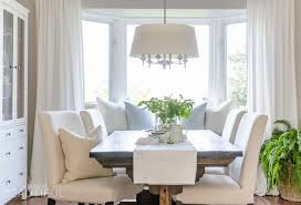 woven wood shades in our living room a burst of beautiful a diy farmhouse dining table and window bench take center stage in this modern farmhouse dining