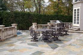 how custom stone inlays elevate an outdoor patio design bergen