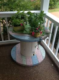 outdoor tables made out of wooden wire spools large wooden spool a little stain and sealant and you have a cool