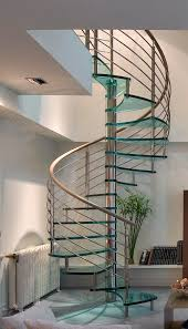 remarkable glass spiral staircases presenting chrome finish for