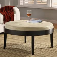 round cocktail ottoman table with white leather tufted top and