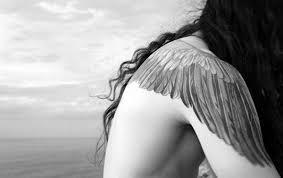 54 photos of wing tattoos