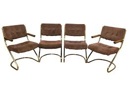 Dinette Chairs by A Mid Century Modern Set Of Four Brass Cantilever Dining Chairs