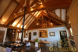 king post oak trusses and rafters framing the ceiling and adding