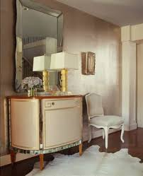 metallic paint wall with mirror and sideboard and chair interior