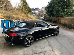 black audi convertible audi a5 cabrio with paky black professional alloy wheels
