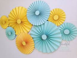 paper fans yellow and aqua rosettes paper fans gender neutral baby