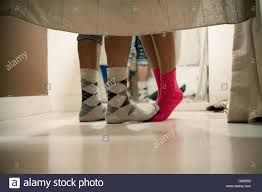 young couple wearing socks in changing room low section stock