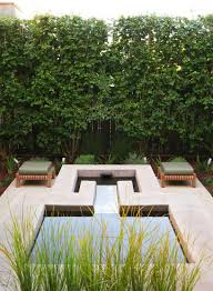 outdoors modern patio with small pool and bench seats also