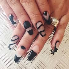 image via black u0026 clear negative space elegant stiletto nail art