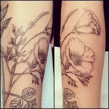black lines poppies tattoo tattoomagz