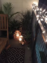 outdoor patio string lighting ideas tropical plants candles lanterns string lights small apartment