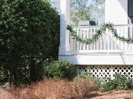 Christmas Fence Decorations How To Make A Life Sized Wreath Snowman Hgtv