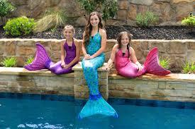 live mermaids swimming pool