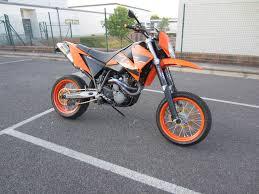 ktm lc4 640 supermoto 2005 in orange with full akrapovic exhaust