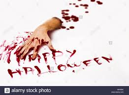 happy halloween image bloody cut hand and happy halloween written with red human blood