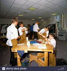high woodwork class students working at bench stock photo