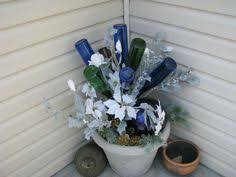 Wine Bottle Planters by Awesome Blossom Southern Garden Yard 49 Bottle Tree By Hopfrogs