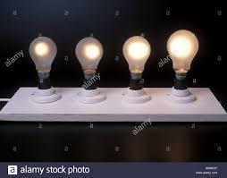 four different wattage light bulbs 40w 60w 100w 150w stock photo